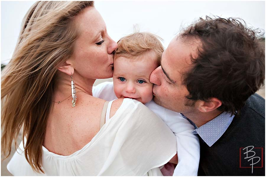 Family at San Francisco kissing baby girl