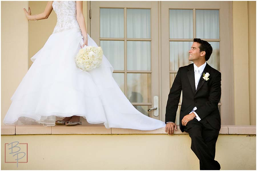 the groom gazes at his bride