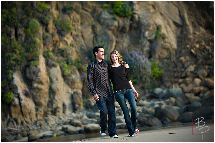 Walking arm and arm along Laguna Beach