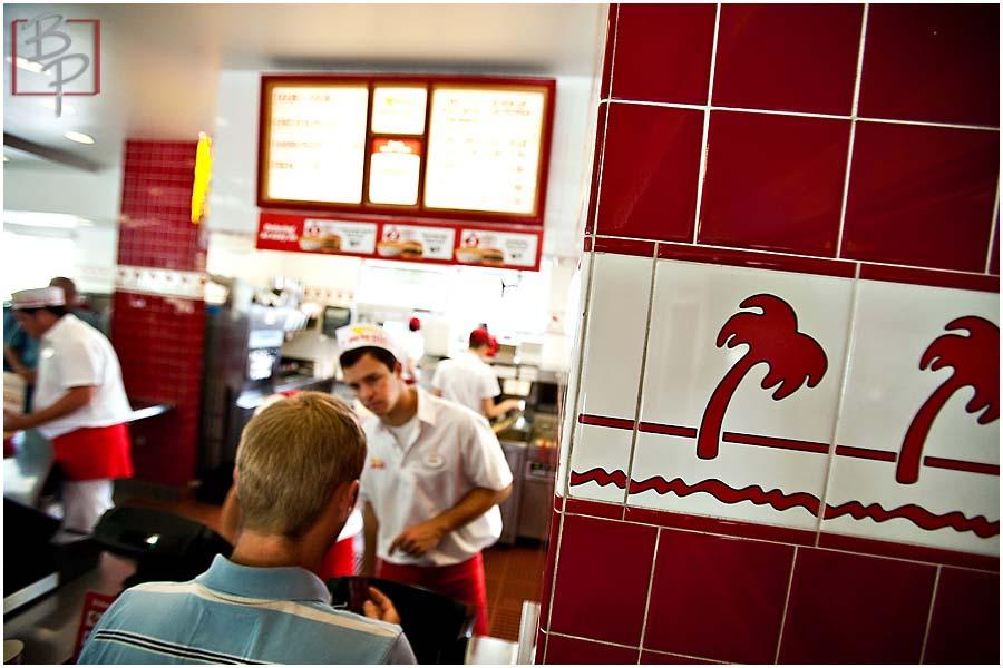Guy ordering at In N Out Hamburger