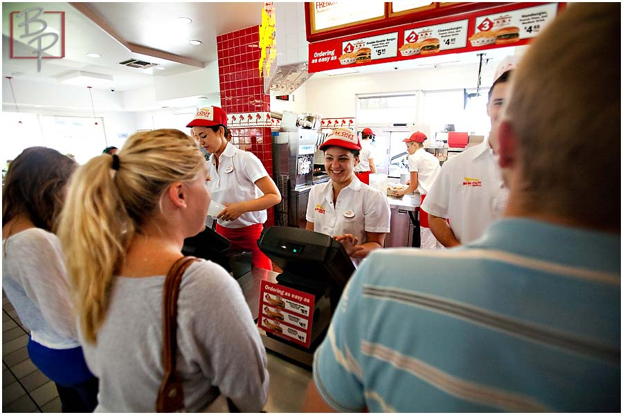 Girl ordering at In N Out counter