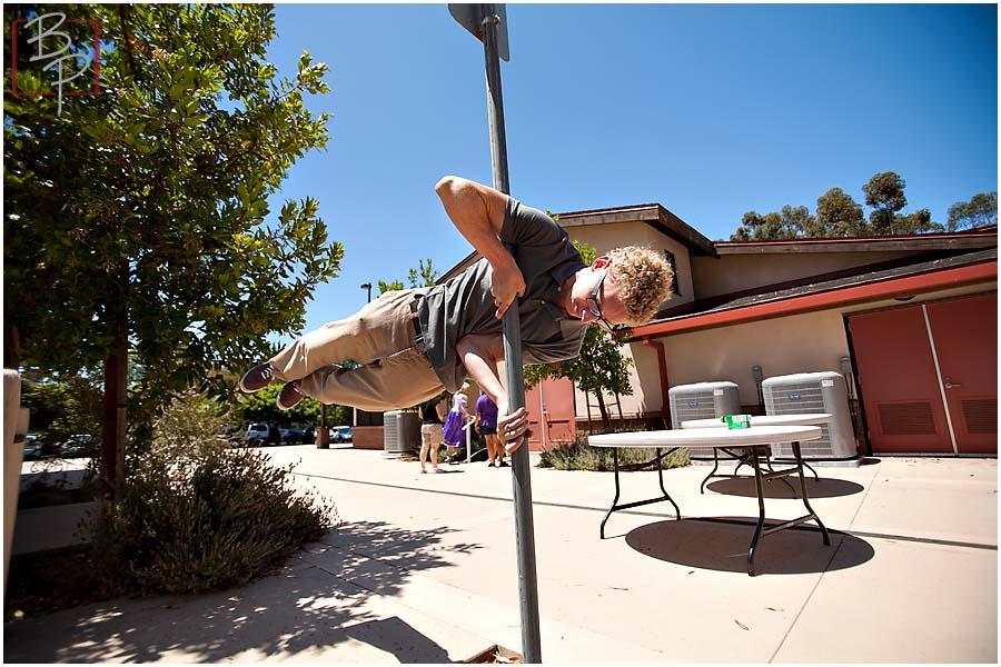 Guy holding acrobatic position at Balboa Park, San Diego