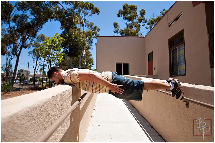 Guy making an acrobatic position at Downtown San Diego