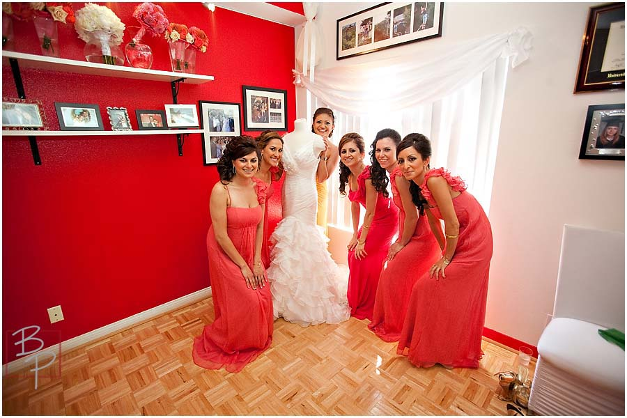 The bride with her bridesmaids before putting on the dress
