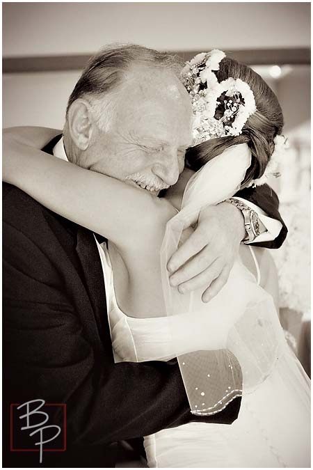 The bride and her father embrace