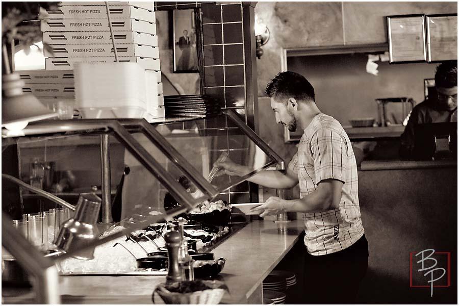 Guy choosing food at the salad bar