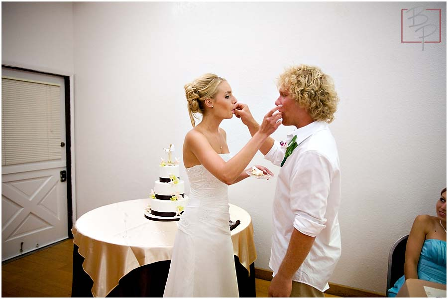 The bride and groom eating cake