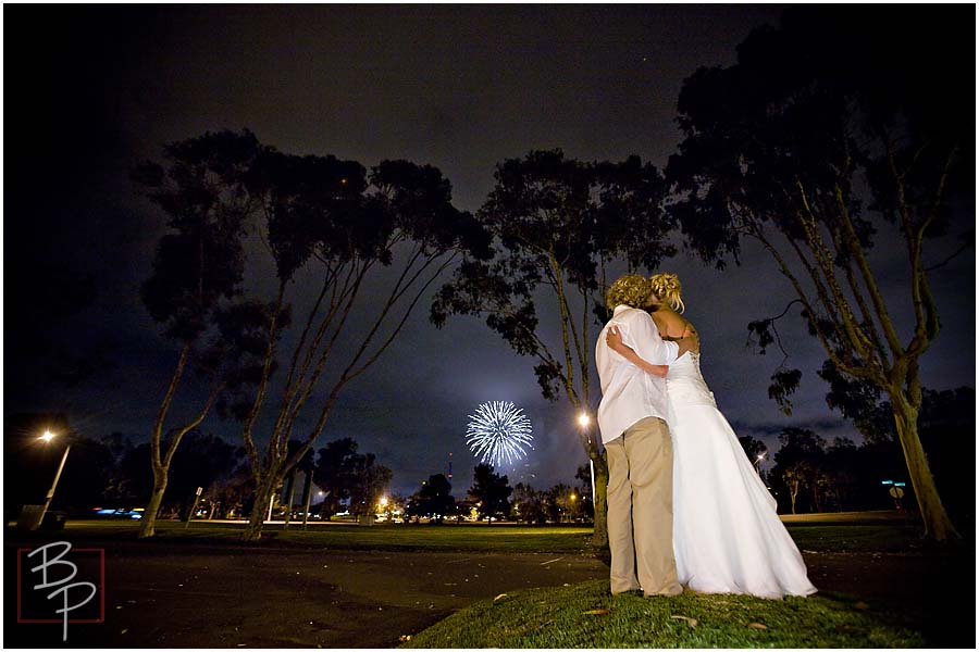 The bride and groom watching fireworks together