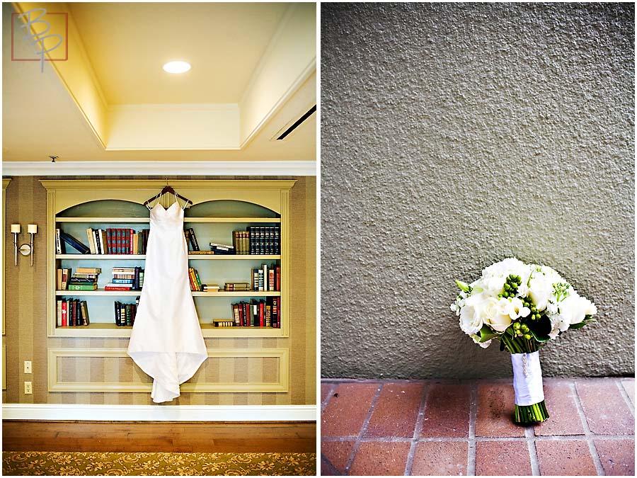 a wedding dress hanging from a book shelf