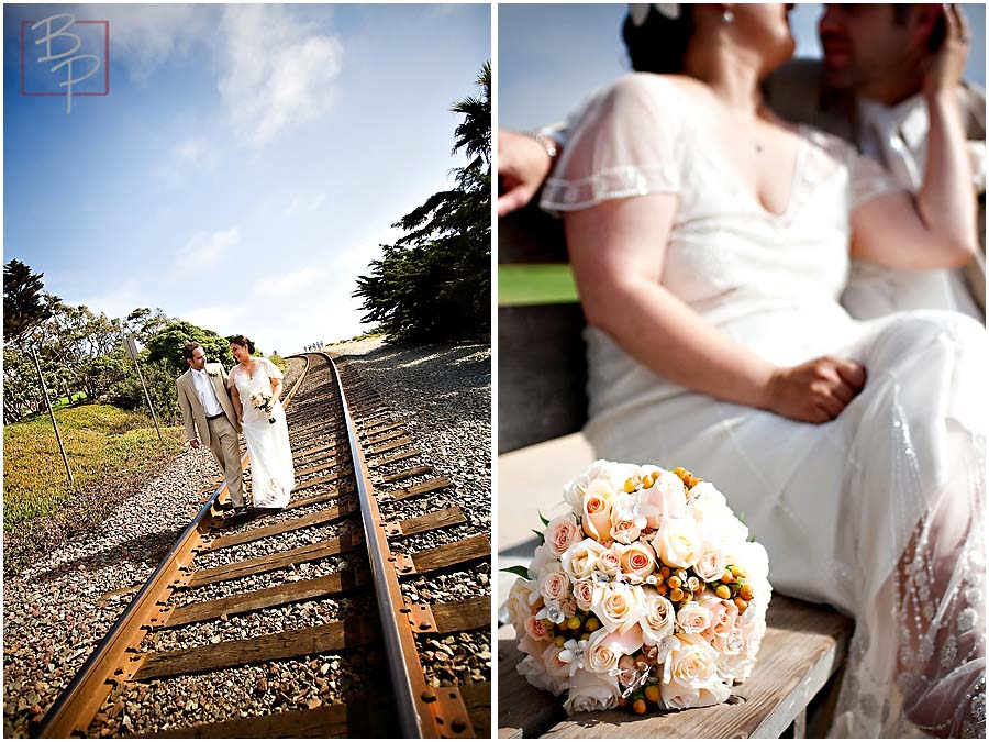 a bride and groom walking on railroad tracks