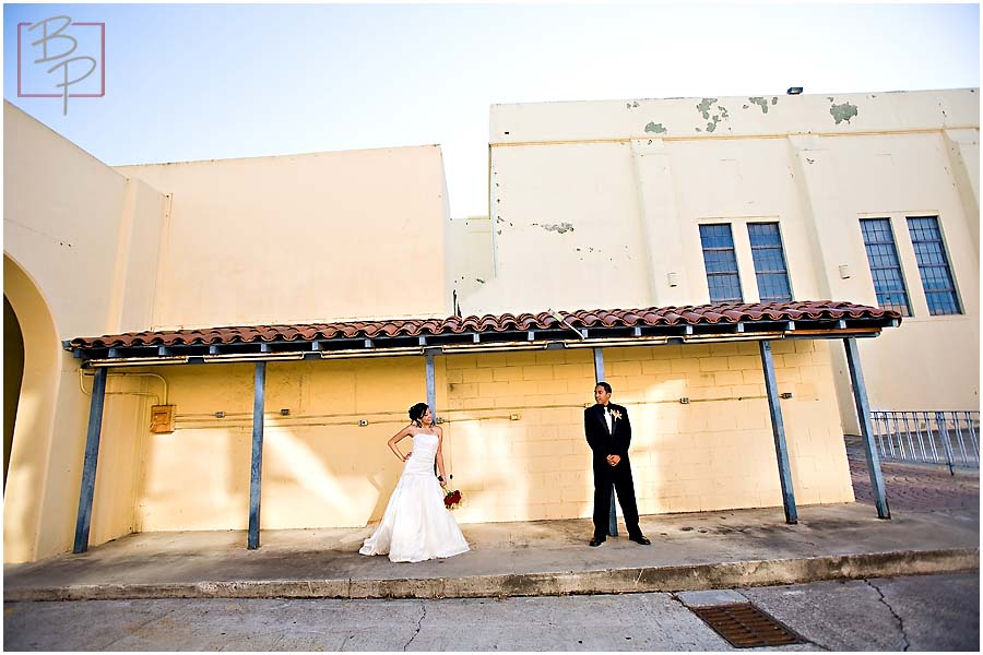 The bride and groom in an urban settings