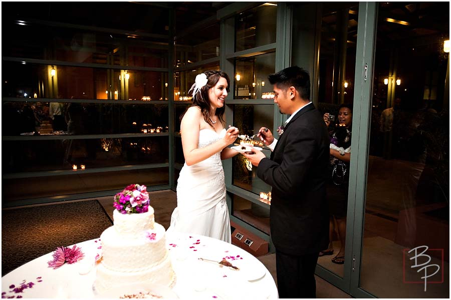 The bride and groom eating their cake