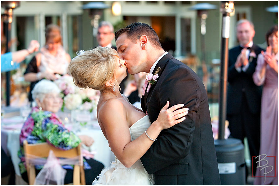 Bride and groom kiss photography